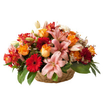 Funeral basket of mixed flowers in red and orange colours